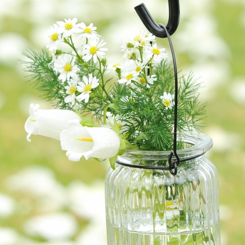 glass jars and shepherd's hooks