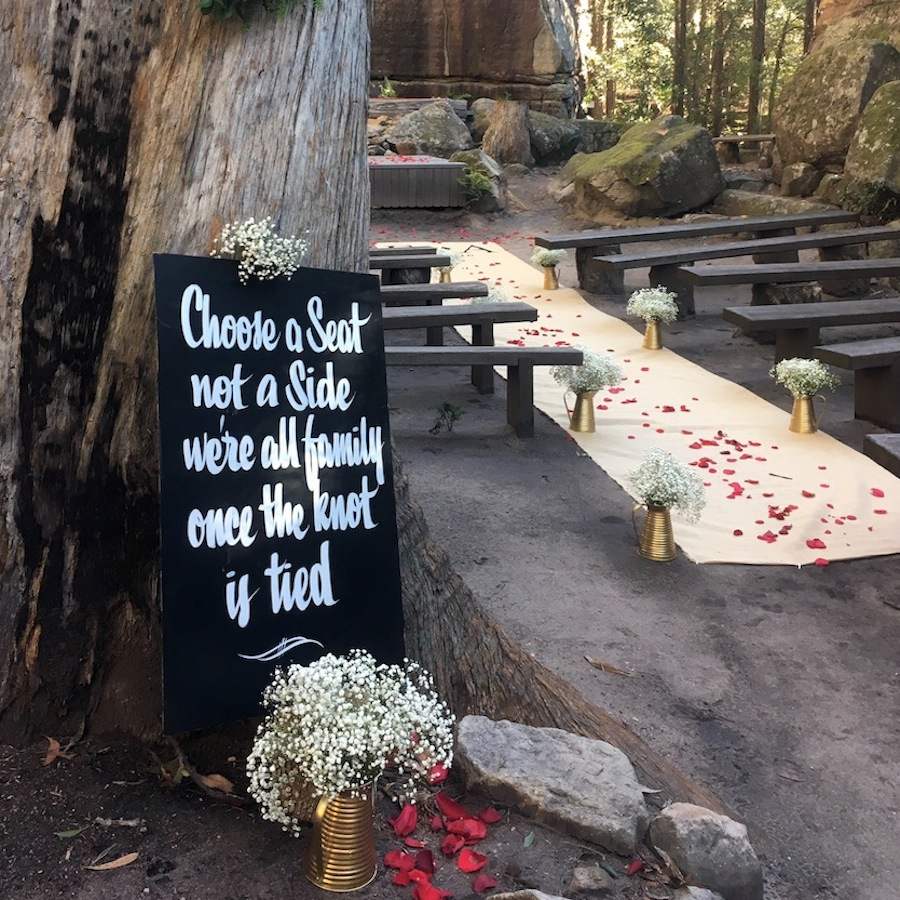 Sign saying 'choose a seat, not a side'