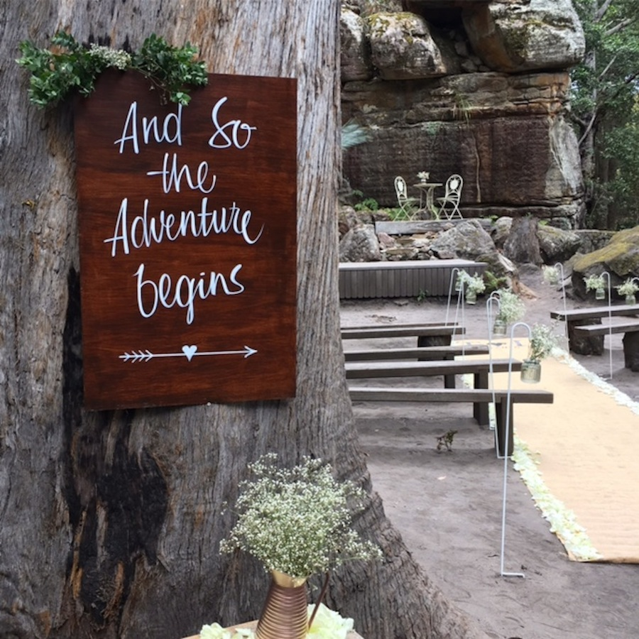 Sign saying 'the adventure begins'