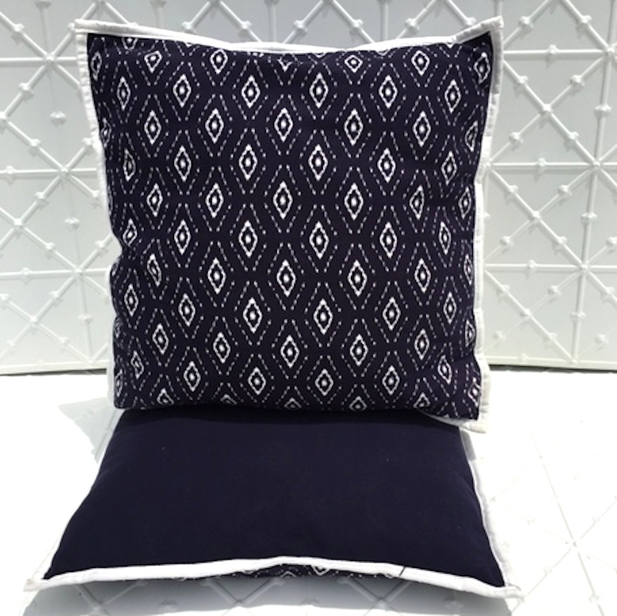 navy aztec patterned cushion for hire