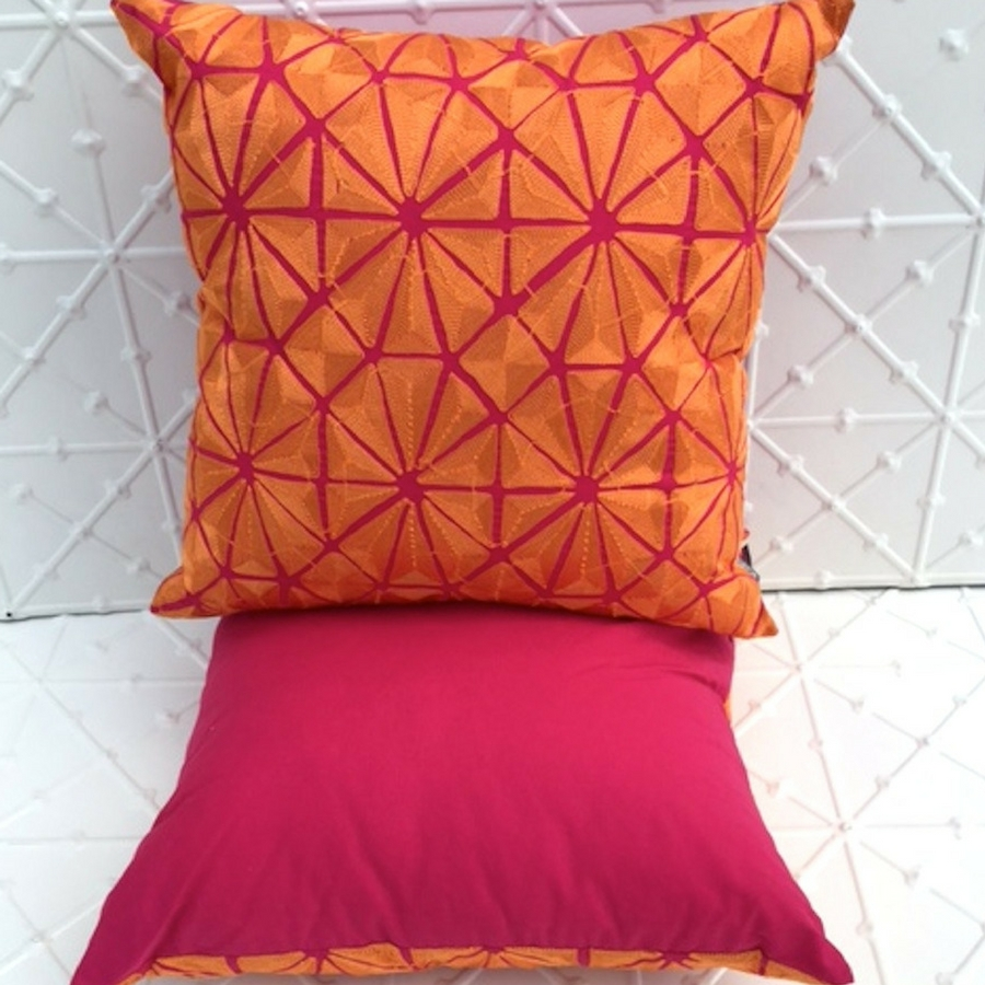 Pink and orange patterned cushion