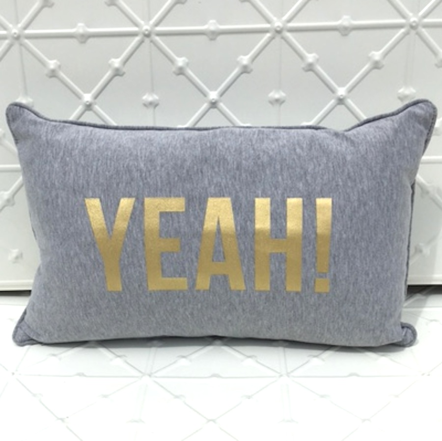 grey and gold 'yeah' cushion
