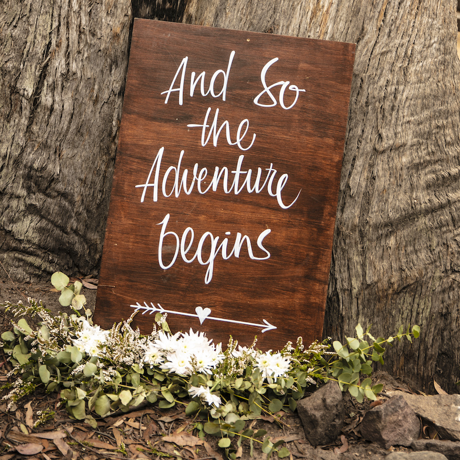 The Adventure Begins Sign